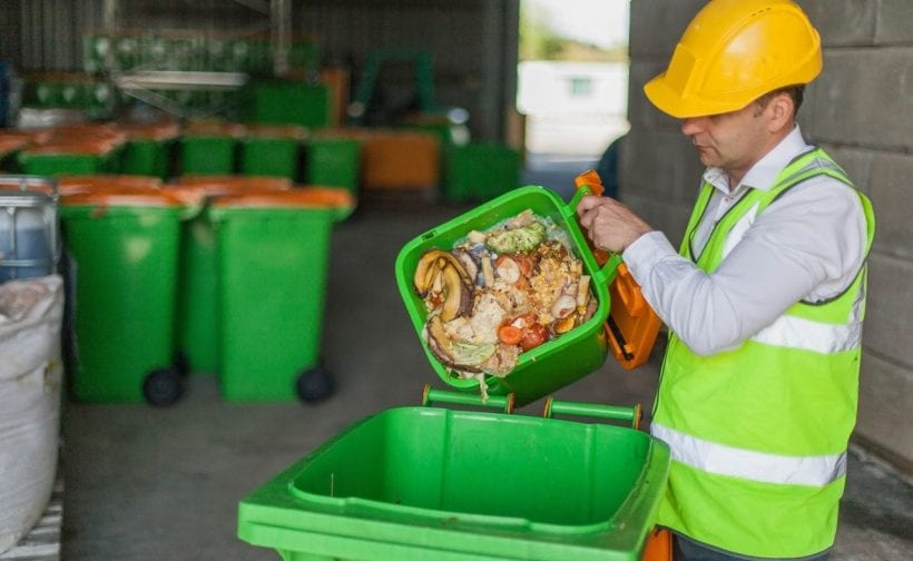 Man emptying food recycling waste