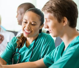 Medical professionals in green scrubs