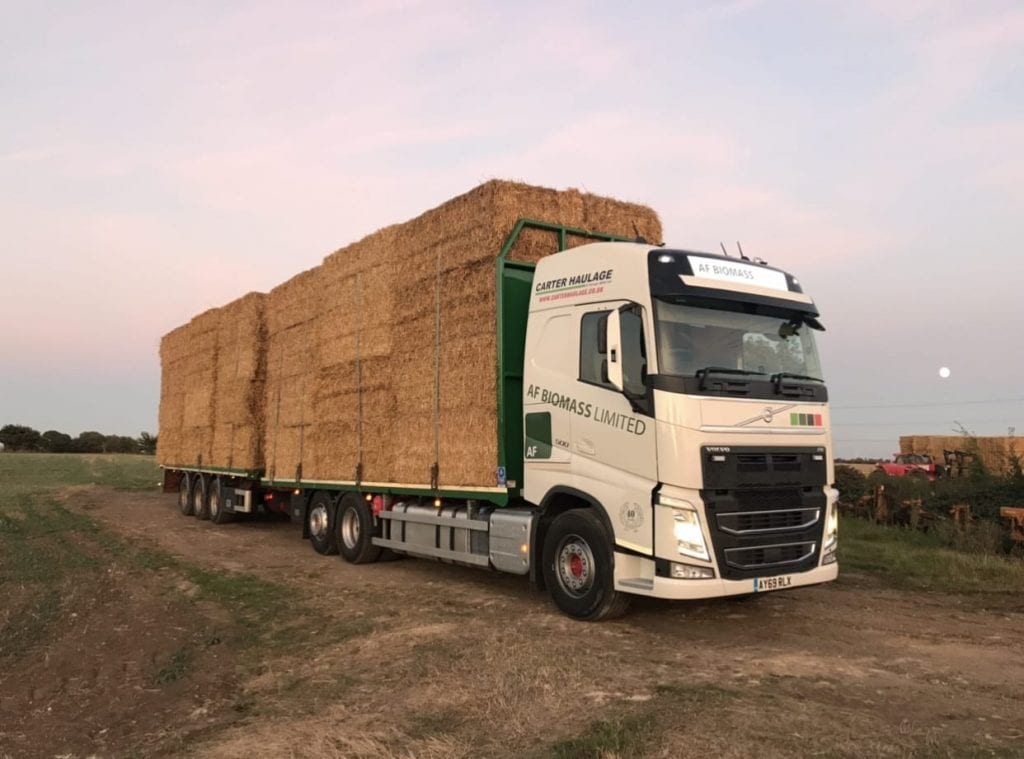 AF Biomass Ltd vehicle loaded with straw bales