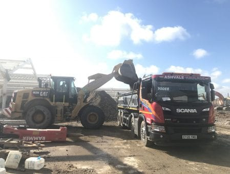Ashvale Haulage tipper truck receiving load from digger