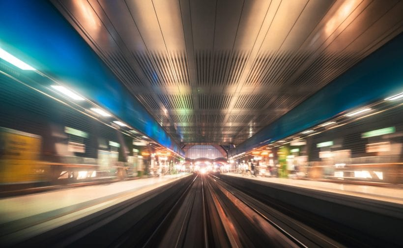 fast train running in a city
