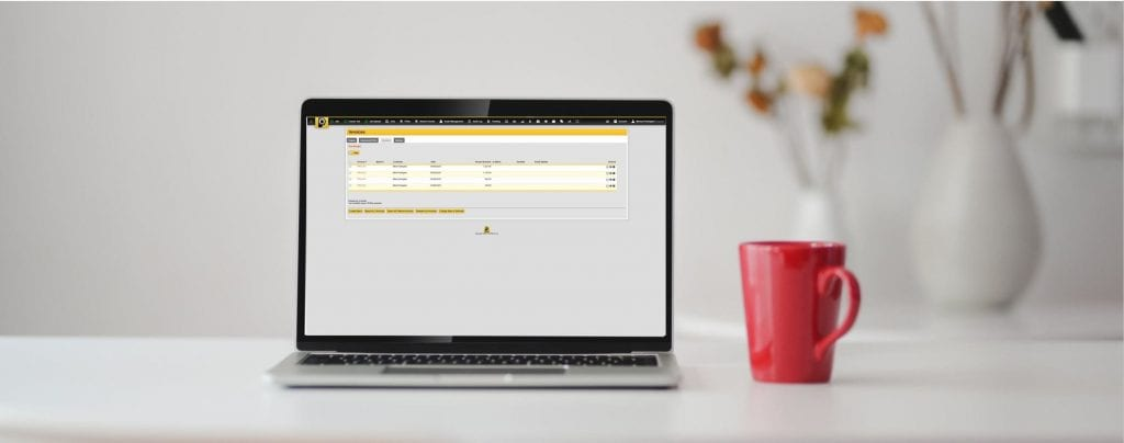 PODFather screen on a lap top next to a red mug