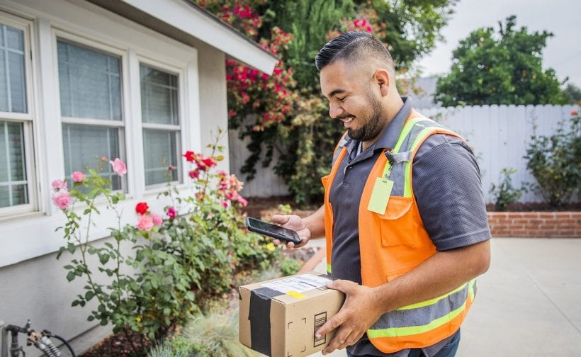 Young man making a home delivery planned by PODFather