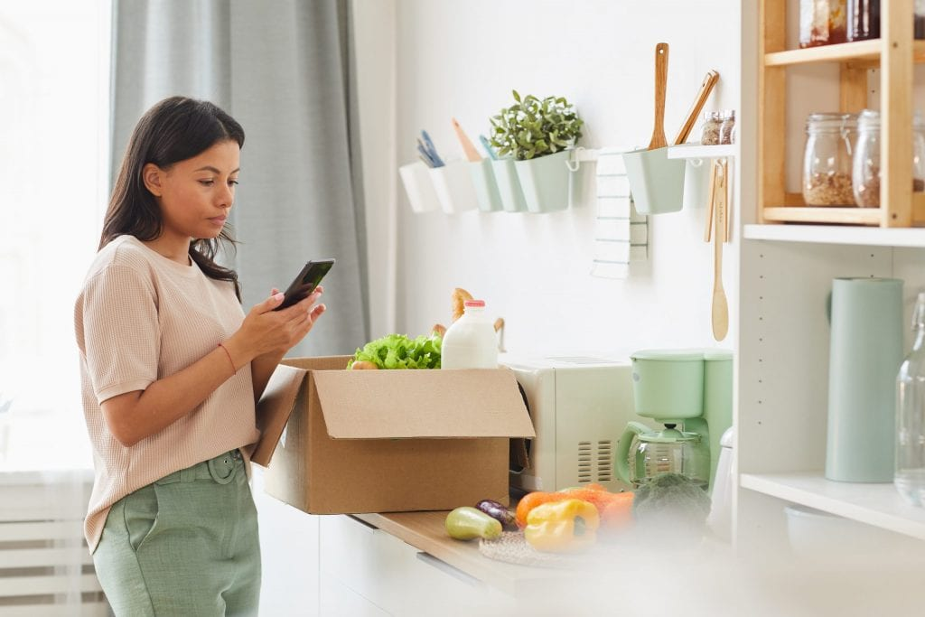 Lady accepting a PODFather home delivery of groceries